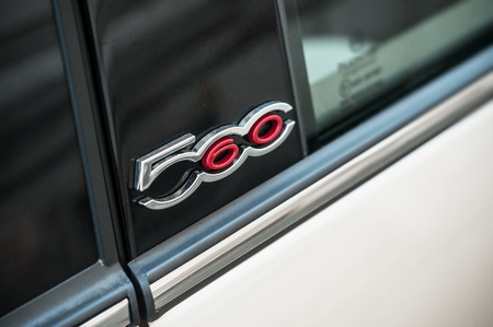 Mulhouse - France - 6 April 2018 - retail of Fiat 500 logo on pearly beige car parked in the street