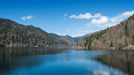 panorama of lake of Kruth with clouds reflection in alsace - France