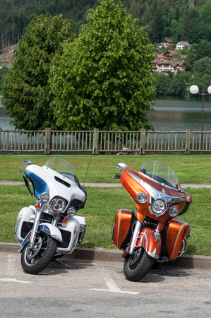 Gerarmer - France -26 May 2018 - closeup of two Harley Davidson mototorbike parked in the street in front of lake Sajtókép