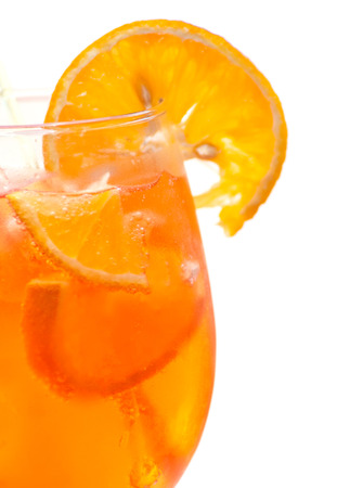 Closeup of orange juice in a glass on white background