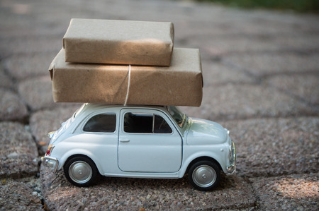 Mulhouse - France - 9 August 2018 -closeup of white Fiat 500 with packages on the roof