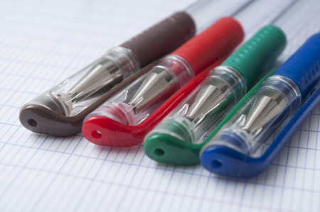 closeup of colorful ballpoint pens on note book background Imagens