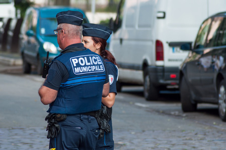 Colmar - France - 1 September 2018 - municipal police men  standing  in the street Standard-Bild - 111725904