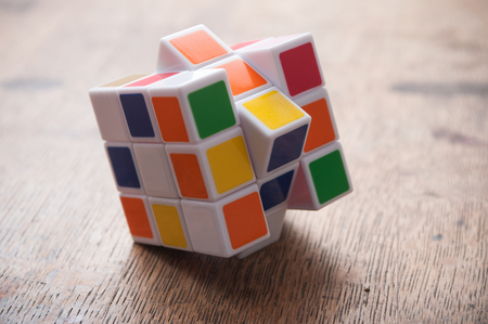 Mulhouse - France - 27 September 2018 - closeup of Rubik's cube on wooden table background