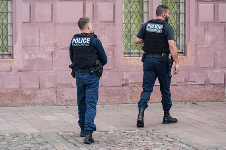 Mulhouse - France - 7 October 2018 - municipal police police men patroling in main place