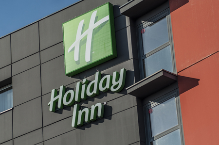 Mulhouse - France - 14 October 2018 - Holiday inn hotel logo on modern building. Holliday Inn is an americain chain company of hostelry