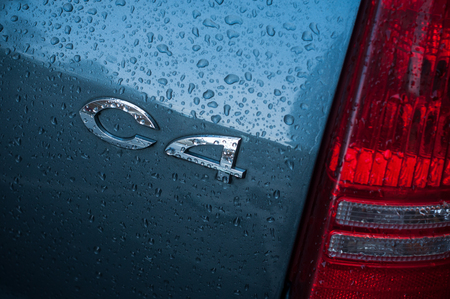 Mulhouse - France - 11 November 2018 - Closeup of rain drops on blue citroen C4 parked in the street