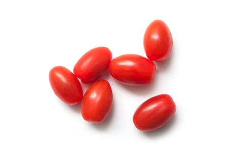 closeup of mini organic tomatoes roma on white background