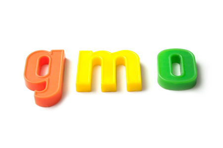 closeup of colorful plastic letters on white background - gmo