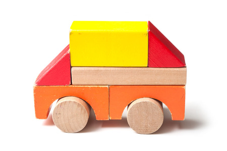 closeup of bus on colorful wooden blocks on white background Stock Photo