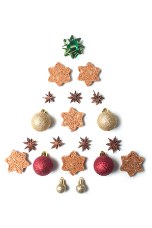 closeup of chirstmas tree concept with christmas decorative objects in shaped christmas tree