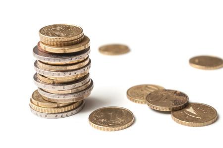 closeup of euros coins pile on white background