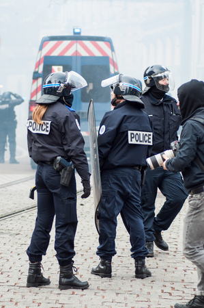 Mulhouse - France - 7 December 2018 - french policemen during the riot of high school students on the sidelines of the movement of yellow vests