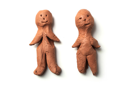 closeup of terra cotta characters in shaped men on white background