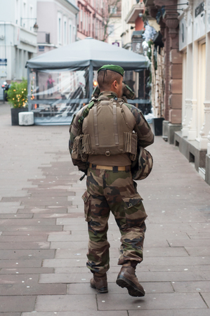 Mulhouse - France - 17 December 2018 - group of military patrolling in christmas market after the terrorist attack in Strasbourg