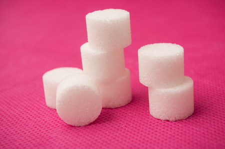 closeup of sugar in shaped circle on pink background