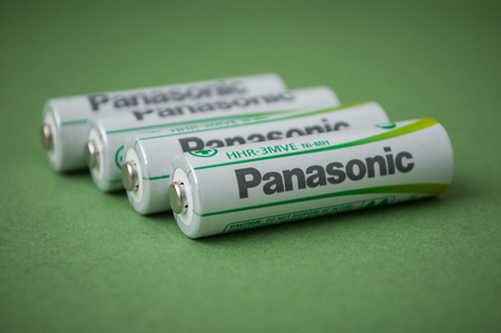 Mulhouse - France - 22 January 2019 - closeup of rechargeable aa alkaline batteries on green background