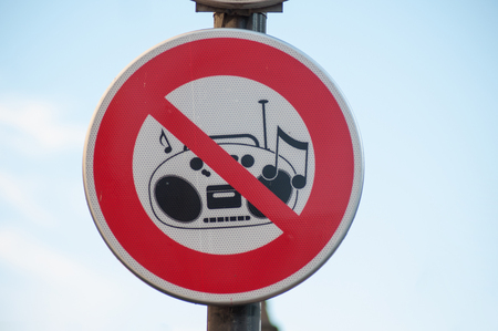 closeup of forbidden music panel in the street