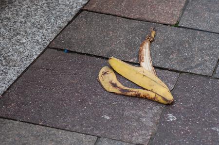 closeup of banana skin on pavement in the street Reklamní fotografie - 118908936