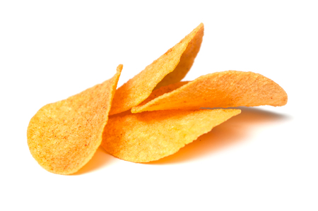 closeup of paprika chips on white background