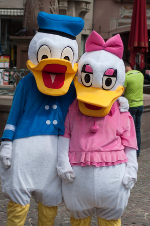 Mulhouse - France - 24 April 2019 - Portrait of people with Donald Duck and daisy costume, Donald Duck is a famous character of Disney