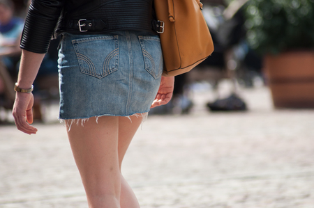 closeup of girl wearing mini blue jeans skirt in the street