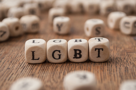 concept word forming with wooden cube on wooden background - LGBT 写真素材
