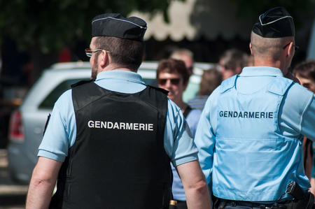Brisach - France - 1 May 2019 - french gendarmerie patrol in lily of the valley party in the street
