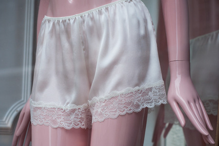 closeup of satin shorty on mannequin in fashion store showroom for women Stock Photo