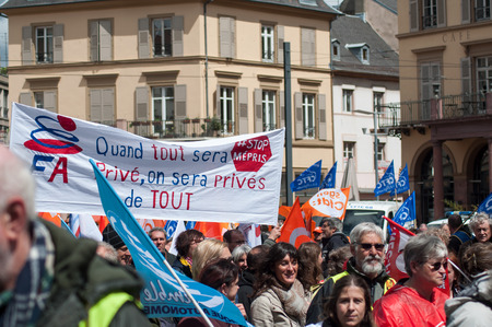 Mulhouse - France - 9 May 2019 - people from public service protesting with flags against the lower wages and new reforms from the government
