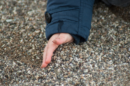 closeup of hand of little boy playing in the land Stock Photo