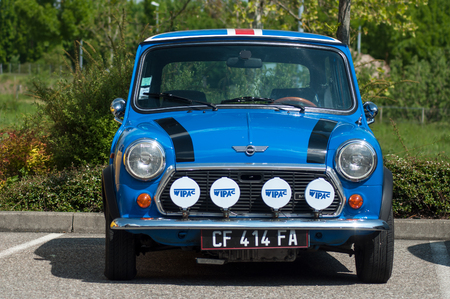 Mulhouse - France - 12 May 2019 - Blue Austin mini with rally equipment parked in the street