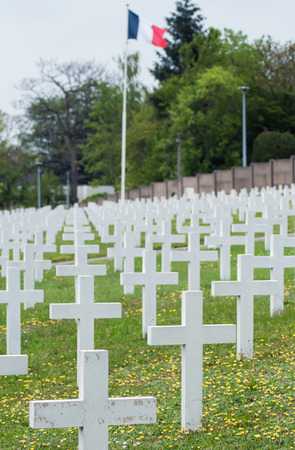 closeup of white cross alignment at military cemetery