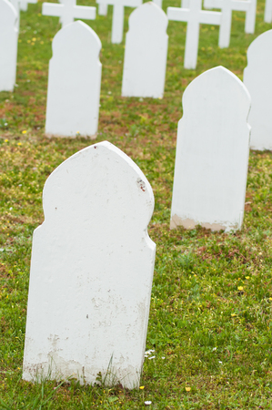closeup of muslim tombs alignment at military cemetery