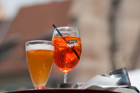 Mulhouse - France - 25 May 2019 - glasses of spritz and beer on restaurant terrace