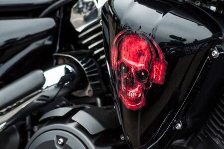 Illzach - France -9 June 2019 - Closeup of red skull painting on Harley Dadidson motorbike