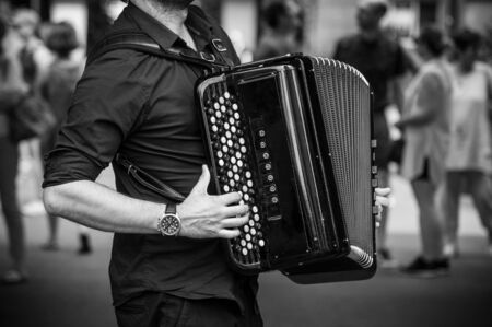closeup of hands of accordionist playing accordion in the street