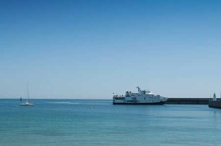 Quiberon - France - 12 July 2019 - Ferryboat arriving at the port