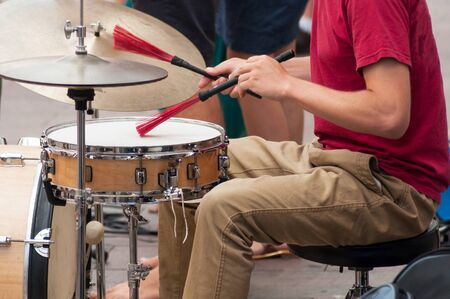 Closeup of drummer playing in the street Imagens