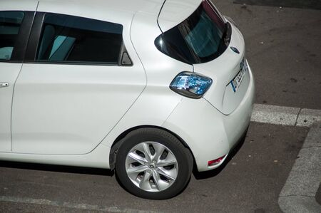 Mulhouse - France - 14 August 2019 - Closeup of white renault Zoe parked in the street  - electric car in the city