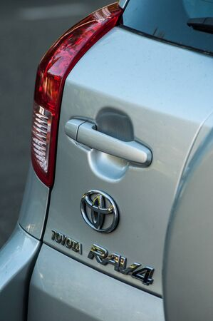 Mulhouse - France - 18 August 2019 - Closeup of logo, handle and rear light  on grey Toyota rav4 parked in the street