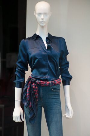 closeup of  blue jeans and sumer clothes on mannequin in women fashion store showroom