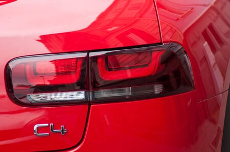 Mulhouse - France - 19 August 2019 - Closeup of rear light of red Citroen C4 crossover parked in the street