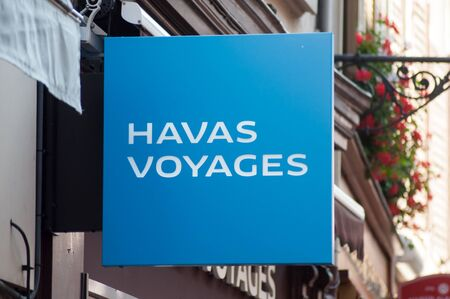 Mulhouse - France - 25 August 2019 - Closeup of Havas voyages sign on travel agency front in the street Redactioneel