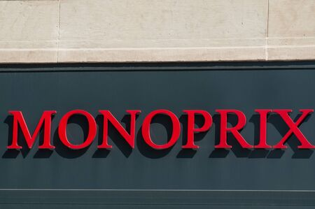 Colmar - France - 24 August 2019 - Closeup of Monoprix sign on supermarket facade in the street