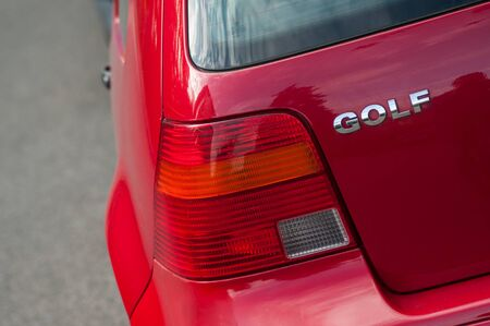 Riedisheim - France - 7 Septembre 2019 - Closeup of rear light and sign on red Volkswagen Golf Type IV parked in the street