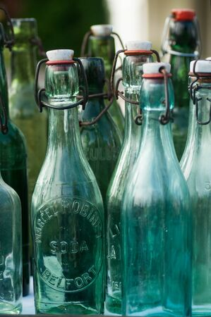Riedisheim - France - 7 Septembre 2019 - Closeup of vintage glass bottles in a flea market in the street 報道画像