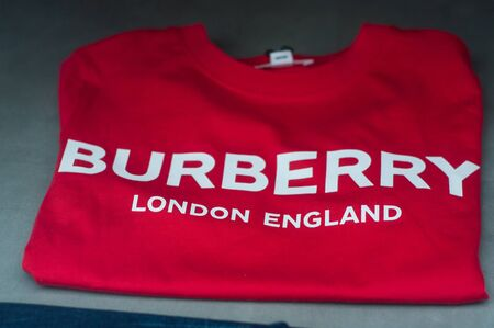 Mulhouse - France - 8 September 2019 - Closeup of Burberry sign on red tee shirt in fashion store showroom