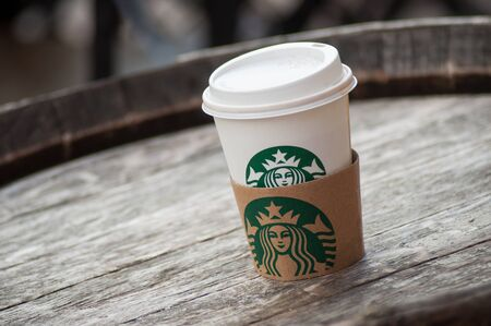 Mulhouse - France - 11 September 2019 - Closeup of white take away cup in outdoor from Starbucks brand, Starbucks is the famous chain of fast food Editorial