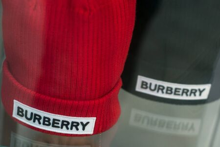 Mulhouse - France - 15 September 2019 - Closeup of red and black Burberry wool hats in fashion store showroom